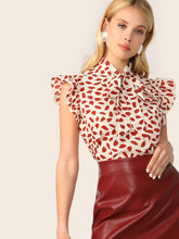Load image into Gallery viewer, Tie Neck Ruffle Trim Petal Print Blouse