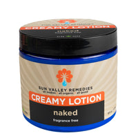 Naked Creamy Lotion in 16 ounce cobalt jar, beige label. Made with organic Aloe Vera. Fragrance free, nourishing, luscious