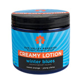 Winter Blues Creamy Lotion in 16 ounce cobalt jar and blue label. Made with organic Aloe Vera, sweet orange, ylang ylang