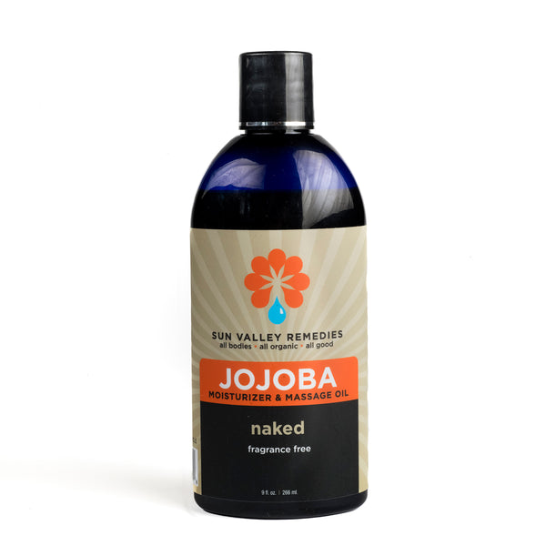 Naked Jojoba oil in 9 ounce cobalt blue jar and beige label. This is a fragrance free, nourishing, rich moisturizer