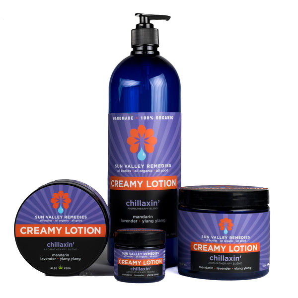 Chillaxin' Creamy Lotion in 4 sizes of cobalt jars and bottles with purple label, includes mandarin, lavender, ylang ylang
