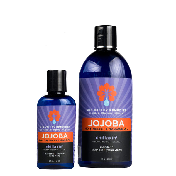Chillaxin' Jojoba oil in 2 different sized cobalt blue bottles and purple label. With Aloe, mandarin, lavender, ylang ylang