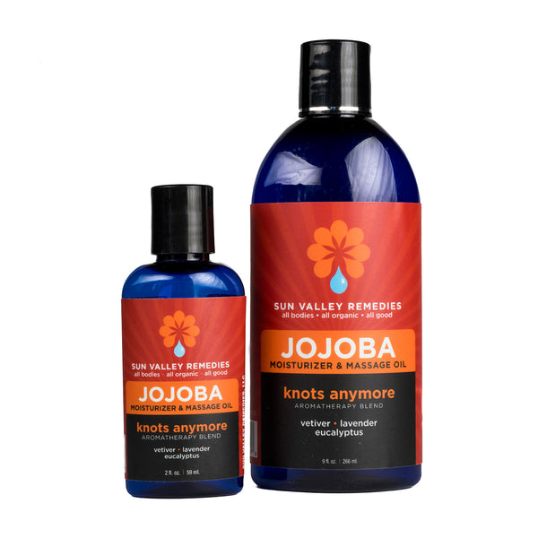 Knots Anymore Jojoba oil in 2 sizes cobalt blue bottles, burgundy label. With organic Jojoba, vetiver, lavender, eucalyptus