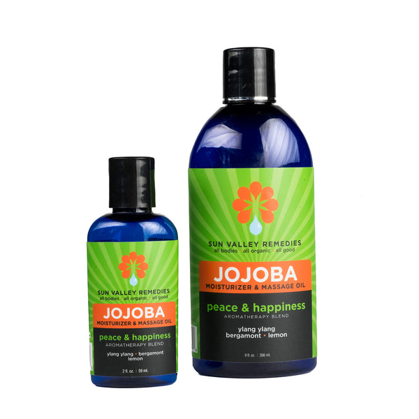 Peace & Happiness Jojoba oil in 2 sizes cobalt bottles, green label. Made with organic Jojoba, ylang ylang, bergamot, lemon