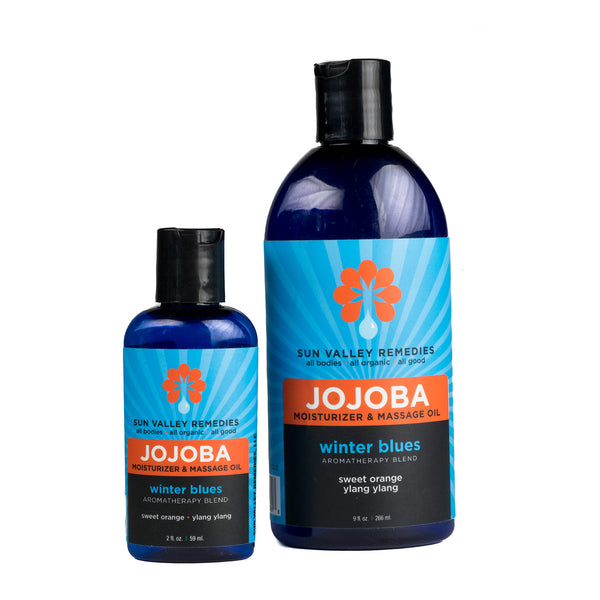 Winter Blues Jojoba non greasy oil in 2 sizes cobalt bottles, blue label. Made with organic Jojoba, sweet orange, ylang ylang
