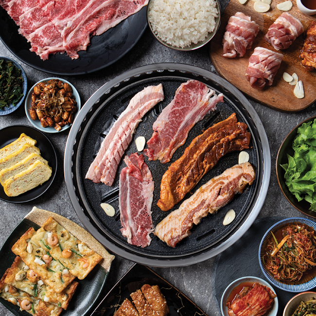 720g of meat. 180g Fresh Woo Samgyup, 240g Fresh Samgyupsal, 180g Soy Garlic Samgyupsal, 120g Dak Ganjeong, Mini Pajeon, Egg Casserole, 2 Rice, Lettuce, Sauces and 6 Side Dishes.
