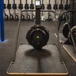 Concept2 Ski Erg with the Equip Wider Base in a gym setting on a black floor