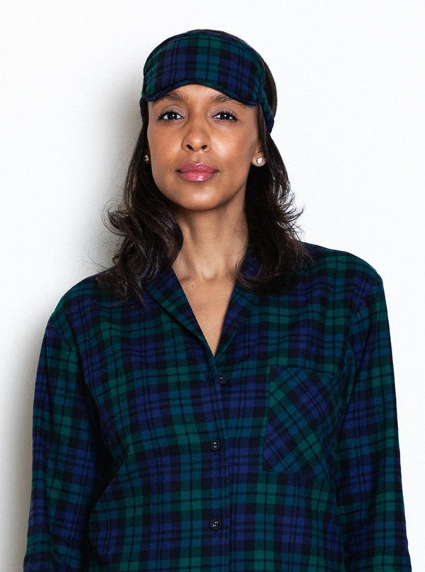 model wearing blackwatch tartan eye face mask and matching pajamas
