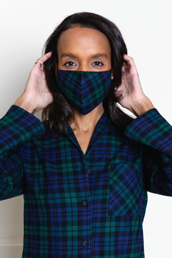 model wearing blackwatch tartan face mask and matching pajamas