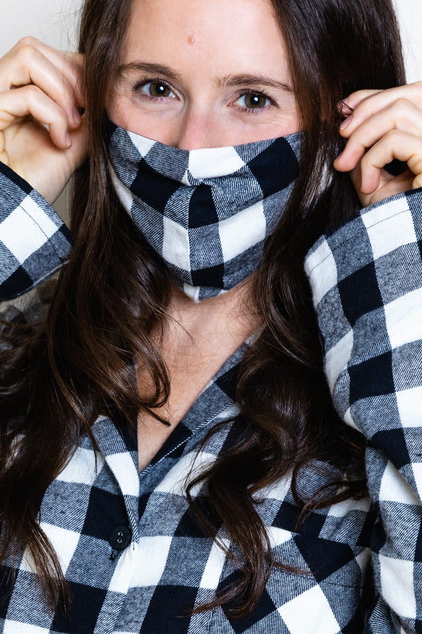 model wearing buffalo check face mask