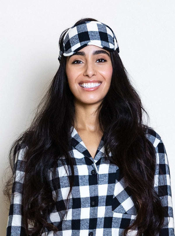 model wearing buffalo check eye mask and matching pajamas