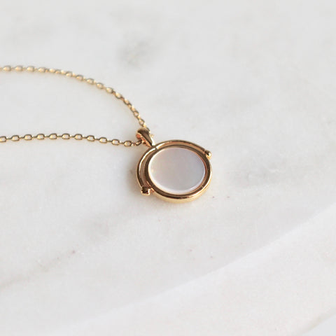 Mother of pearl globe necklace