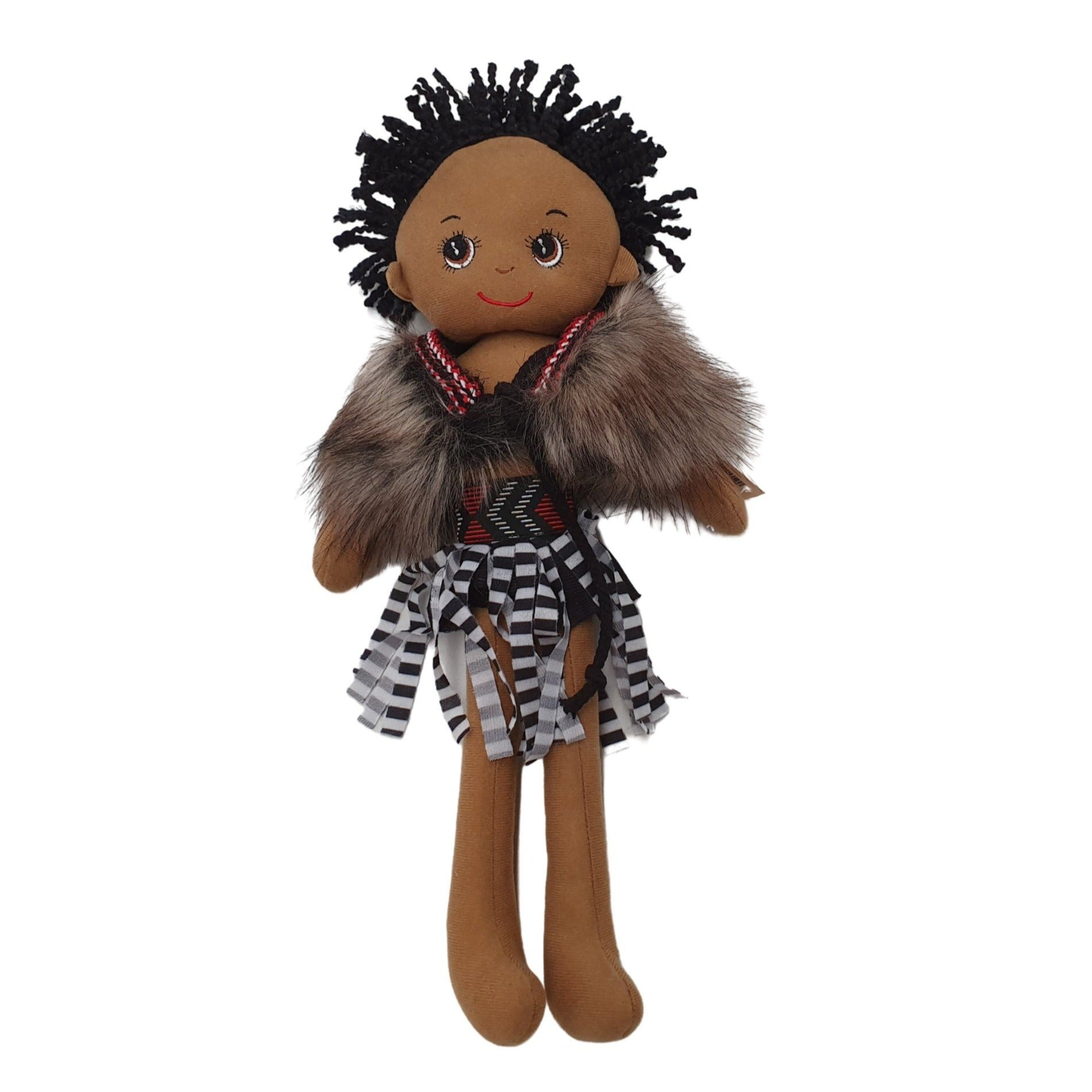 Korowai maori cloak worn by boy doll in New Zealand