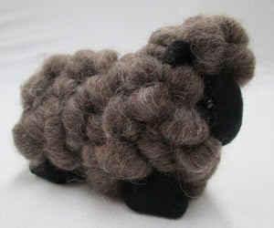 Brown wool toy sheep in New Zealand