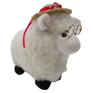 toy sheep  with hat and toy glasses