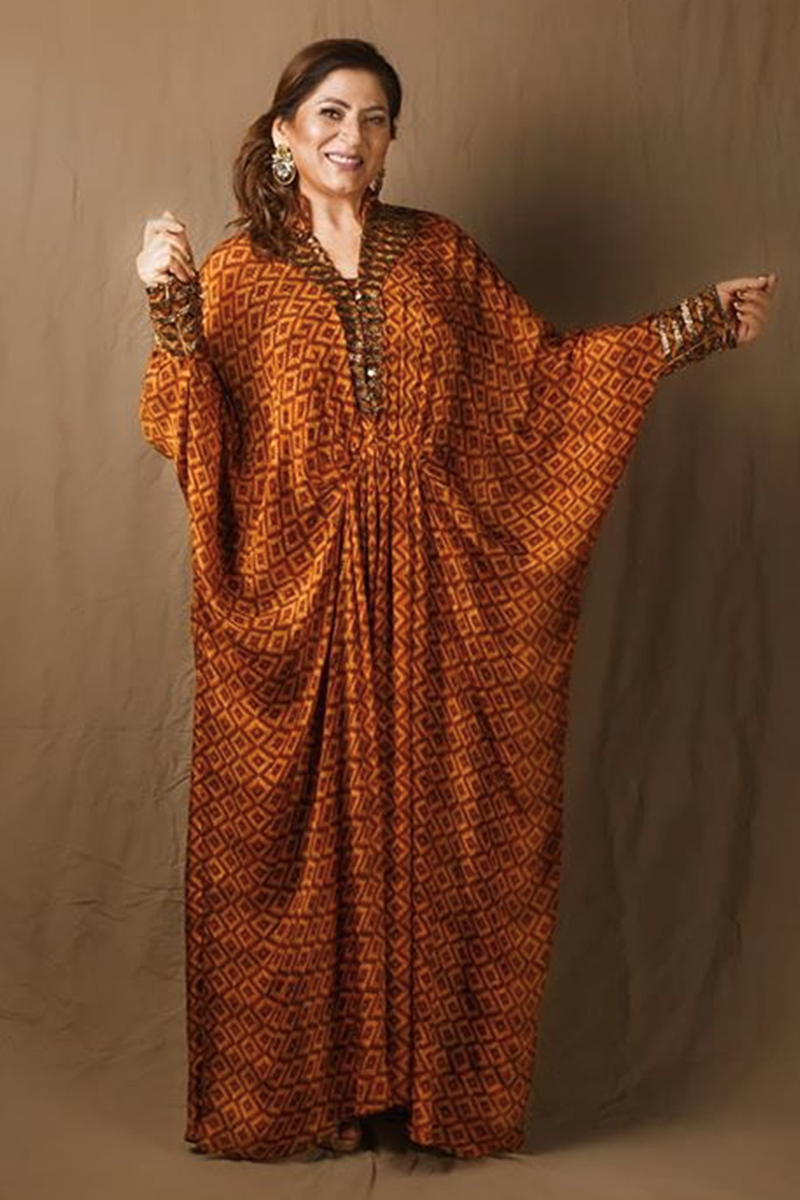 Archana Puran Singh In Beige-Brown Basket Weave Print Pleated Maxi Dress With Embroidered Belt
