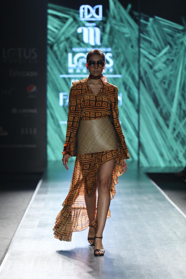 Winnie Harlow In Orange-Brown Basket Weave Print Ruffled Skirt With Side Slit