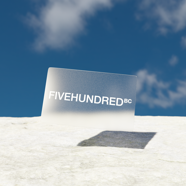 Fivehundred BC Gift Card Image. This is a CGI image of a transparent card floating above a coarse, concrete ground with a blue sky in the background and thin, white clouds