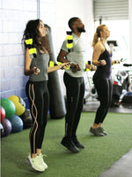 Three-people-in-a-gym-jumping-rope-using-Spin-Strong