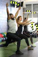 Three-people-combining-Spin-Strong-arm-exercise-with-lunges