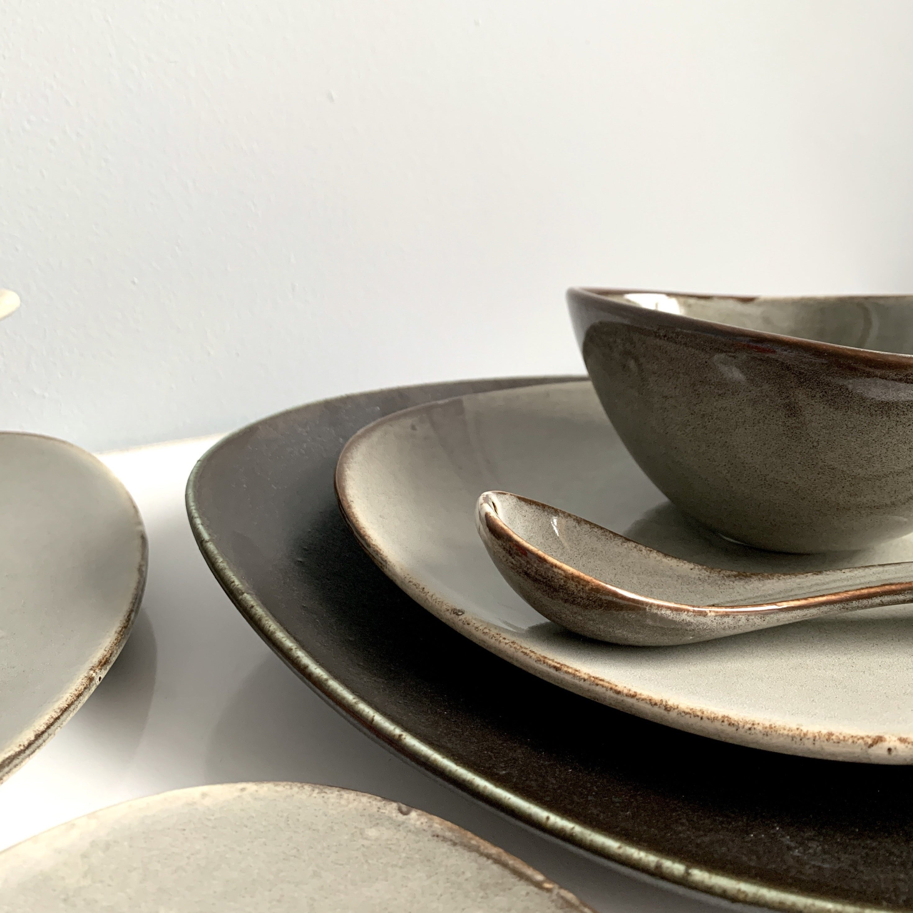 unique asymmetrical dinnerware set - serving and sharing plate set in grey and black