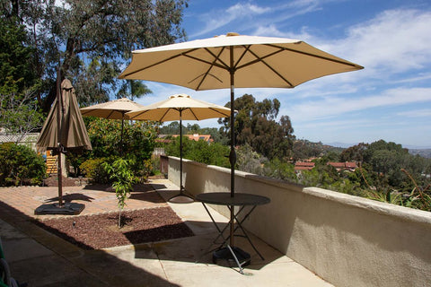 Clean patio umbrellas providing shade outside.
