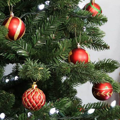 Make sure to decorate your Christmas tree with plenty of gorgeous hanging Christmas ornaments.