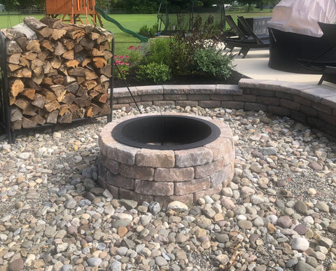DIY fire pit with a fire pit liner in the backyard.