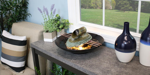 Slate indoor tabletop fountain creating feng shui in the living room