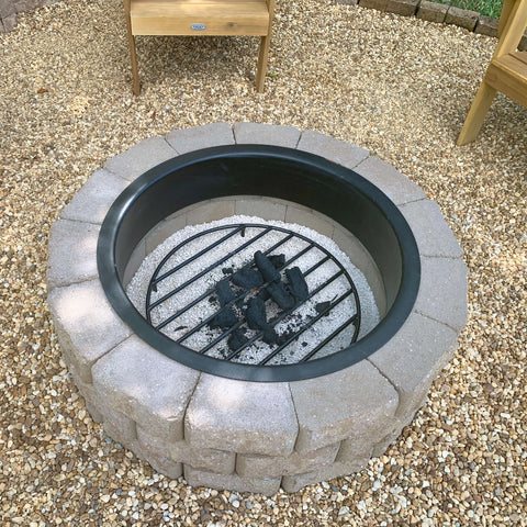Wood grate being used for extra warmth in a winter fire pit