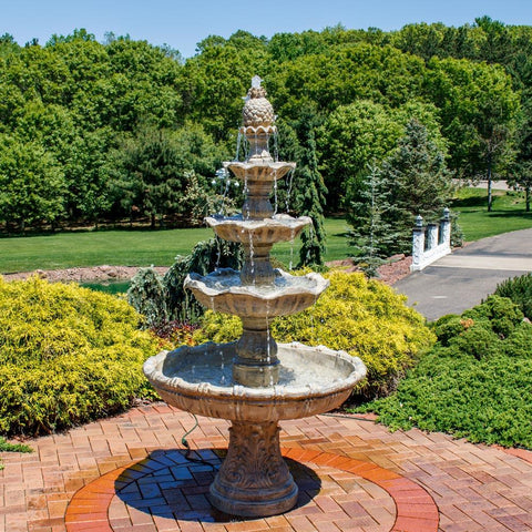 Large tiered fountain beautifully running thanks to proper fountain maintenance