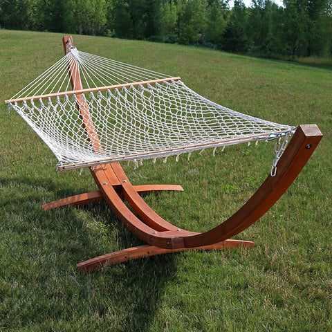 Classic rope hammock with wooden hammock displayed on the lawn.