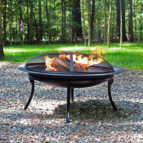 Portable fire pit being used for camping