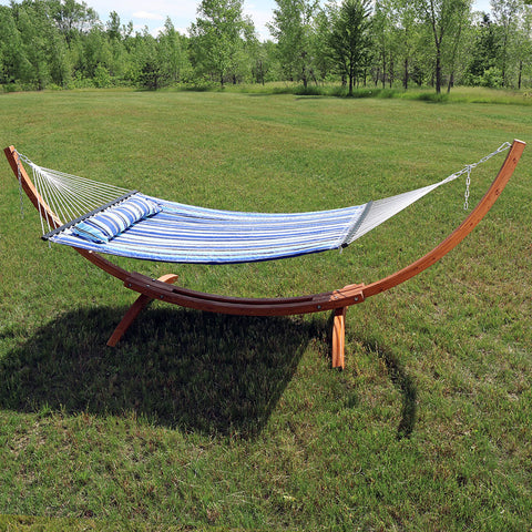 Hammock with a wooden stand in the yard.
