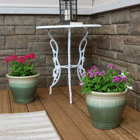 Set of garden planters properly watered on the patio.