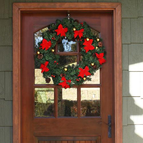 Adding a Christmas wreath to your door is a great way to decorative your room for Christmas
