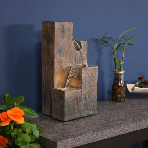 An indoor tabletop fountain displayed on the countertop