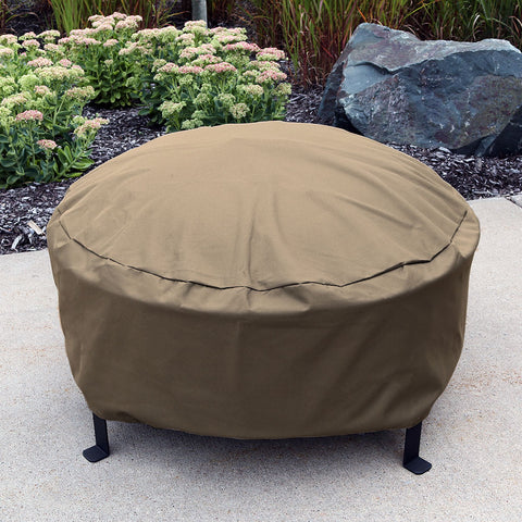 Durable fire pit cover protecting a wood burning fire pit