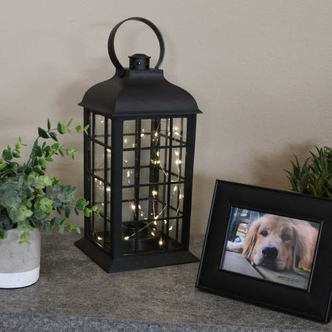 Use this battery-powered indoor lantern with LED lights to light up your room this holiday season.
