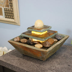 Small tabletop fountain displayed on table