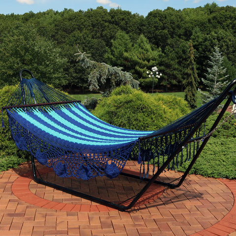 Traditional American style hammock with stand on the patio.