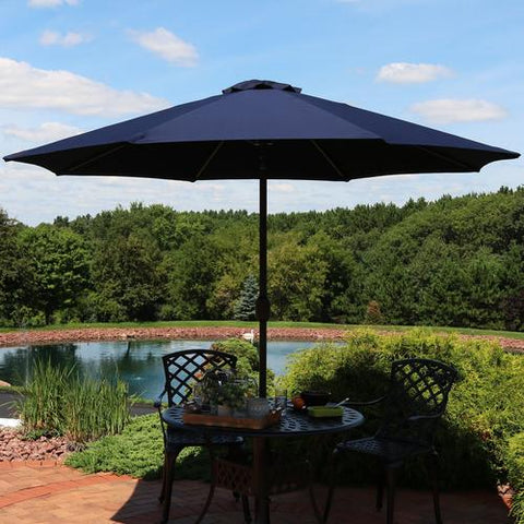 9 foot patio umbrella giving shade to a outdoor table.