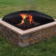 Wood burning fire pit with a protective spark screen.