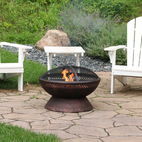 Sunnydaze wood burning fire pit with a roaring fire