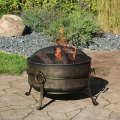 Sunnydaze Cauldron Fire Pit displayed outside with a roaring flame.