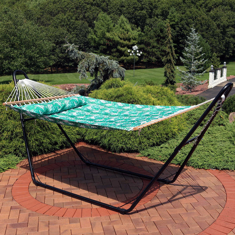 Quilted hammock with stand on the patio.