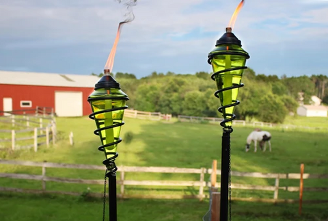 Patio torches on display near the farm.