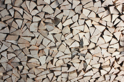 Use dry, seasoned firewood to start a fire in a fire pit