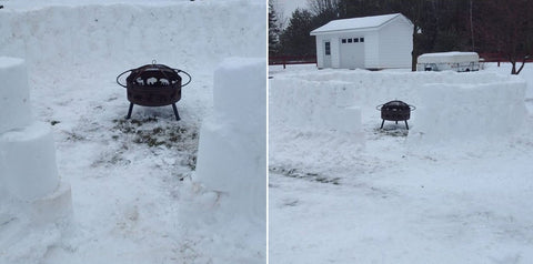 Fire pit in winter being used as a warm fort
