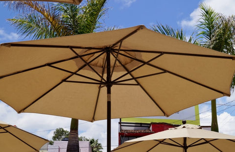 Clean outdoor umbrella fabric giving protection from the sun.